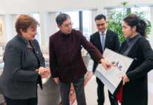 """IMF China Executive Director Jin Zhongxia thanked Giorgieva's support for China during the coronavirus outbreak and presented her with calligraphy artwork that read, """"Spring comes back to Earth."""" (Photo: IMF)"""