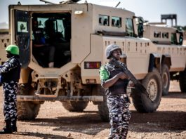 A group of Nigerian Policemen deployed in Somalia as part of the African Union peacekeeping mission patrol in Beledweyne, Somalia, on December 14, 2019. - The rains have inundated big areas surrounding Beledweyne area forcing thousands of people to leave their houses and look for humanitarian assistance while living in displacement camps. Due to climate change and human activities, cycles of floods and droughts have become more recurrent and completely unpredictable in Somalia exposing hundreds of thousands of people every year to vulnerability and displacement. (Photo by LUIS TATO / AFP)