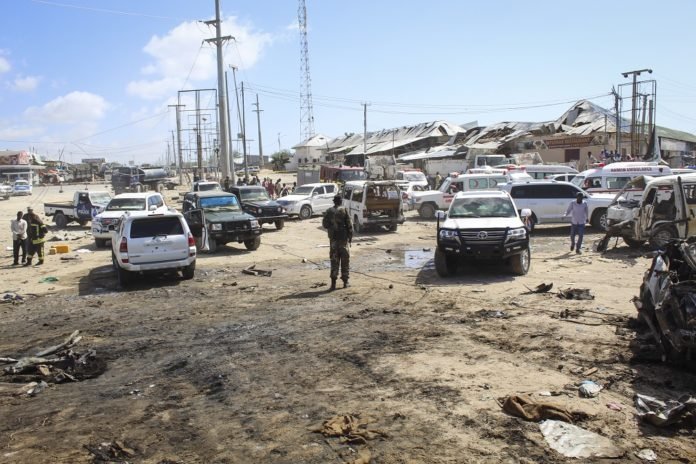 A security officer is seen at the scene of a large explosion near a check point in Mogadishu, Somalia, 28 December 2019. A source at a hospital said that the death toll has risen to at least 76 in what is believed to have been a car bombing. The explosion rocked an area near the junction called Ex-Control Afgoye, in a southwestern suburb of the capital Mogadishu. EPA/SAID YUSUF WARSAME