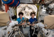 U.S. astronauts Jessica Meir (L) and Christina Koch pose in the International Space Station in a photo released October 17, 2019. NASA/Handout via REUTERS. THIS IMAGE HAS BEEN SUPPLIED BY A THIRD PARTY. TPX IMAGES OF THE DAY