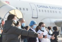 The 958 medical personnel from the fifth medical team sent by Jiangsu province depart for Hubei from Nanjing Lukou International Airport and Wuxi Sunan Shuofang International Airport, Feb. 9, 2020. So far, Jiangsu province has sent a total of 1,438 medical staff to help Hubei. Photo by Shao Dan, People's Daily