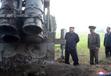 """Photo provided by Korean Central News Agency (KCNA) on Sept. 11, 2019 shows Kim Jong Un, top leader of the Democratic People's Republic of Korea (DPRK), again guiding a test-firing of """"super-large multiple rocket launcher"""" on Sept. 10, 2019. (KCNA/Handout via Xinhua)"""