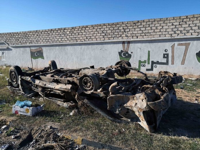 Photo taken on Dec. 26, 2019 shows a damaged vehicle after an airstrike in Zawiya, Libya. The UN-backed Libyan government on Thursday condemned an airstrike carried out by the rival eastern-based army on the city of Zawiya. The airstrike on Zawiya, some 45 km west of the capital Tripoli, killed and injured a number of civilians, the UN-backed government said in a statement. (Photo by Hamza Turkia/Xinhua)