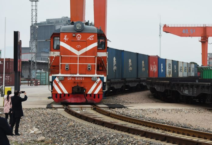The X8074 China-Europe freight train carrying 86 standard containers of auto parts, departs Yiwu in east China's Zhejiang province for Minsk, Belarus, Feb. 10, 2020. As the first operational China-Europe freight train after the Chinese New Year holiday, the train marked the resumption of normal operation of freight rail services between China and Europe. Photo by Gong Xianming, People's Daily Online