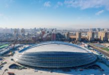 "The landmark venue for the 2022 Winter Olympics - the National Speed Skating Oval, also known as the ""Ice Ribbon"", is capped, Dec. 31, 2019. Photo by He Yong/People's Daily"