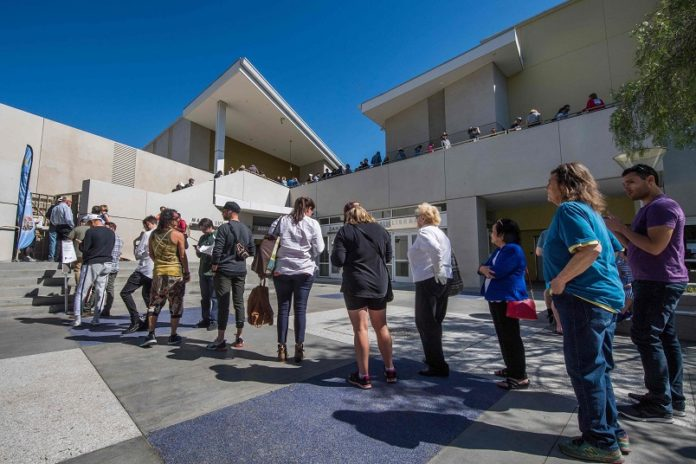People wait to vote during the presidential primary at the Santa Monica Public Library in Santa Monica, California on Super Tuesday, March 3, 2020 - Fourteen states and American Samoa are holding presidential primary elections, with over 1400 delegates at stake. Americans vote Tuesday in primaries that play a major role in who will challenge Donald Trump for the presidency, a day after key endorsements dramatically boosted Joe Biden's hopes against surging leftist Bernie Sanders. The backing of Biden by three of his ex-rivals marked an unprecedented turn in a fractured, often bitter campaign. (Photo by Mark RALSTON / AFP)