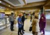 Employees wearing masks guide customers to follow the tape marks on the floor as authorities called for social distancing amid concerns over the spread of novel coronavirus at a bakery in Islamabad, capital of Pakistan on March 21, 2020. According to the government statistics, the number of confirmed coronavirus patients rose to 534 in Pakistan on Saturday. (Xinhua/Ahmad Kamal)