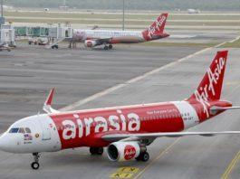 [Reuters]AirAsia planes are seen on the tarmac of Kuala Lumpur International Airport 2 (KLIA2) in Sepang