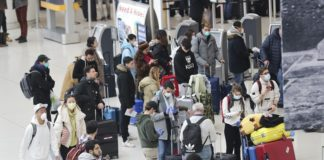 Passengers wait to depart at John F. Kennedy International Airport in New York, the United States, March 13, 2020. The United States implemented the restrictions which suspend all travel from European countries except Britain for 30 days in a measure faced with further spread of the COVID-19 Friday at midnight. U.S. President Donald Trump on Friday declared a national emergency to open up 50 billion U.S. dollars in federal aid to help combat the spread of COVID-19 across the country. (Xinhua/Wang Ying)