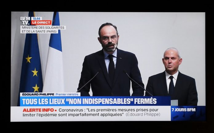 The TV grab shows French Prime Minister Edouard Philippe (L) delivering a speech in Paris, France, on March 14, 2020. With the COVID-19 confirmed actively spreading across the country, France entered