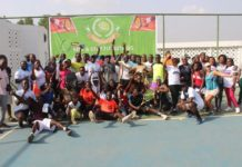The picture shows members of both clubs (Pulse fitness tennis club and G.O/ Eusbett tennis club) in a unity pose.