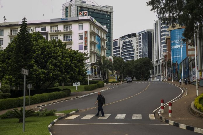 A pedestrian crosses a road in downtown Kigali, Rwanda, on March 22, 2020. On Saturday, Rwanda announced stricter measures to be implemented for the next two weeks in a bid to contain the spread of coronavirus, banning unnecessary movements of residents and ordering border closure. (Photo by Cyril Ndegeya/Xinhua)