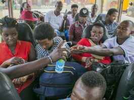 Bus passengers sanitize their hands in Kigali, capital city of Rwanda, March 14, 2020. Rwanda on Saturday registered its first case of the novel coronavirus (COVID-19), the ministry of health said here. (Xinhua/Cyril Ndegeya)