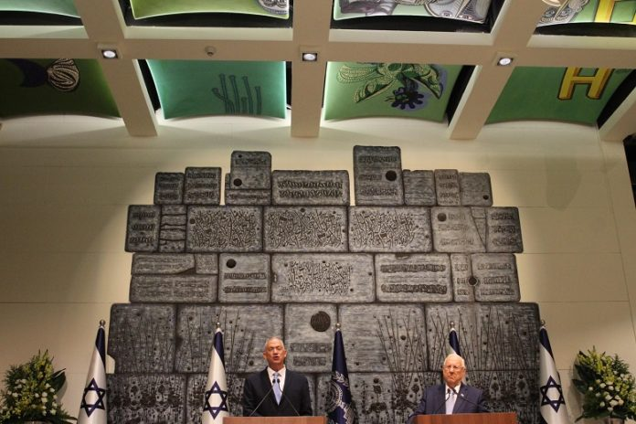 Israeli President Reuven Rivlin (R) and Blue and White party leader Benny Gantz attend a ceremony at the President's residence in Jerusalem, on Oct. 23, 2019. Benny Gantz, Israel's former military chief, was given on Wednesday the mandate to form a new government after Prime Minister Benjamin Netanyahu's failure to do so amid a political deadlock. (Photo by Gil Cohen Magen/Xinhua)