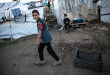 Photo taken on Nov. 29, 2019 shows children playing in the Moria refugee camp on Lesvos island, Greece. Europe should share responsibility and help ease the suffering of thousands of refugees and migrants living in Greece, United Nations High Commissioner for Refugees (UNHCR) Filippo Grandi said on Nov. 28. (Photo by Lefteris Partsalis/Xinhua)