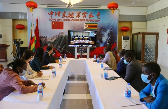 Senior officials from Zimbabwe's Ministry of Health and Harare City Council participate in the China-Africa Video Conference on COVID-19 in Harare, Zimbabwe, March 18, 2020. Africans have hailed China's efforts and measures taken to curb the COVID-19 outbreak, expressing their keen interest to learn its experience as the African continent reported more and more confirmed cases. TO GO WITH
