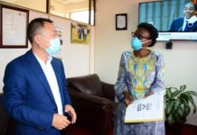 Doctor Ruth Aceng (R), Minister of Health of Uganda speaks to an official from Sunbelt Textiles Company Limited, in Kampala, capital of Uganda, April 2, 2020. Sunbelt Textiles Company Limited on Thursday donated 30,000 USD to help Uganda to fight COVID-19 pandemic. (Xinhua/Nicholas Kajoba)