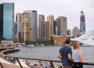 Tourists are seen at a dock in Sydney, Australia, March 10, 2020. The number of confirmed COVID-19 cases in Australia has reached 100, Federal Health Minister Greg Hunt announced on Tuesday. (Xinhua/Bai Xuefei)