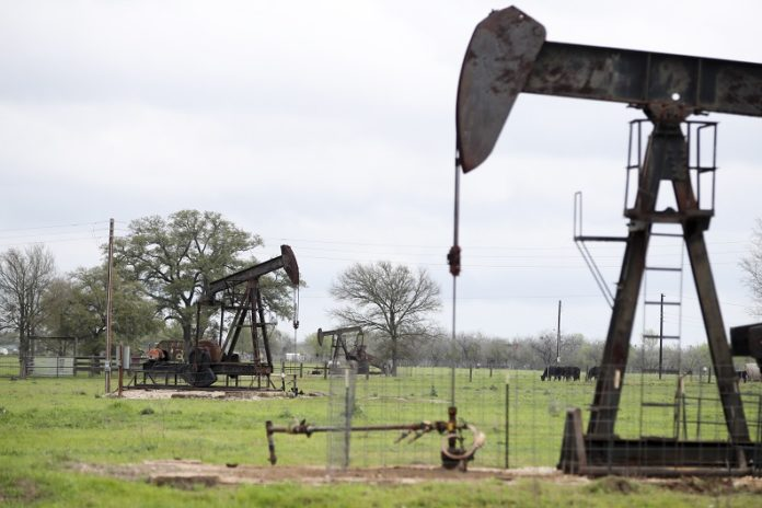 File photo taken on March 12, 2019 shows operating oil pumps in Luling of Texas, the United States. U.S. oil prices turned negative on April 20, 2020. West Texas Intermediate crude for May delivery shed more than 300 percent to settle at -37.63 U.S. dollars per barrel on the New York Mercantile Exchange. (Xinhua/Wang Ying)