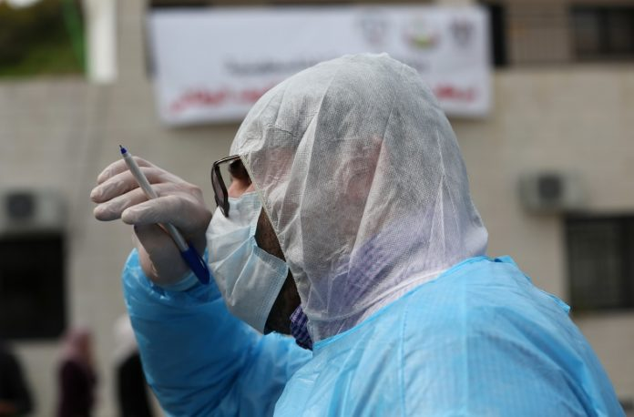 A member of Palestinian medical team is seen at an emergency center for monitoring, screening and preventive health care education about COVID-19, which was recently established by the Palestinian Ministry of Health, in the West Bank city of Nablus, March 9, 2020. Palestine on Monday reported six new cases of coronavirus, bringing the total number of the infected Palestinians to 25. (Photo by Ayman Nobani/Xinhua)