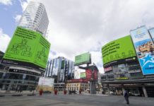 A man wearing a face mask looks at screens displaying the Ontario government's messages on COVID-19 at Yonge-Dundas Square in Toronto, Canada, on April 9, 2020. Canada could see 22,580 to 31,850 COVID-19 cases and 500 to 700 deaths by April 16, the Public Health Agency of Canada said Thursday. (Photo by Zou Zheng/Xinhua)