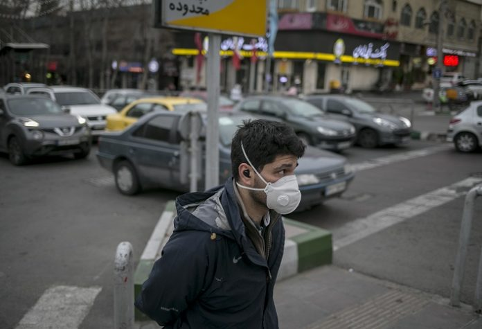 A man wearing mask walks on a street in Tehran, Iran, on March 7, 2020. The novel coronavirus has claimed 194 lives in Iran, the Ministry of Health and Medical Education announced Sunday. Kianush Jahanpur, head of Public Relations and Information Center of the ministry, said the total number of the confirmed cases now stands at 6,566, of whom 2,134 have recovered. Tehran records 1,805 cases of infection, the highest number among the country's provinces, followed by Qom with 685 cases and Mazandaran with 620 cases. (Photo by Ahmad Halabisaz/Xinhua)