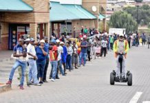 Citizens line up outside a supermarket in Johannesburg, South Africa, April 2, 2020. The spread of COVID-19 continued unabated in South Africa on Thursday, with 82 new cases reported, Health Minister Zweli Mkhize said.