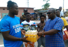 Champion lifterAmoah (left) receiving his items from John Vigah, Communications Director of GWF