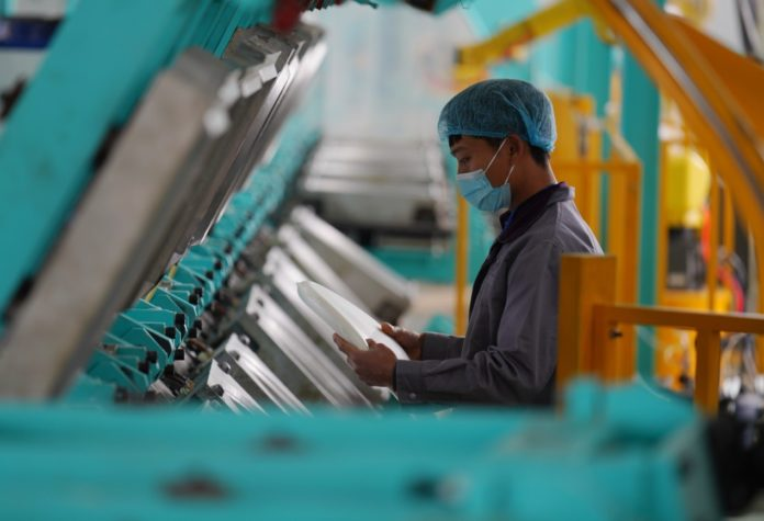Smart production lines are operating at full speed at a household supply company in Nanxun district, Huzhou, east China's Zhejiang province for orders of memory foam pillows and electronic mattresses, April 3, 2020. Photo by Li Zeming, People's Daily Online