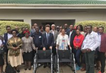 Miles Nan (4th L, front), Executive Chairman of Botswana China Friendship Association (BOCFA) and Morwadi Mosenki (3rd R, front), Serenity Rehabilitation Center 's operations manager pose for a group photo during a donation ceremony at Tlokweng village in Gaborone, capital of Botswana, March 13, 2020. (Xinhua)