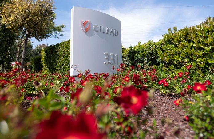 Gilead Sciences headquarters sign is seen in Foster City, California on April 30, 2020. - Gilead Science's remdesivir, one of the most highly anticipated drugs being tested against the new coronavirus, showed positive results in a large-scale US government trial, the company said on April 29, 2020. (Photo by Josh Edelson / AFP)