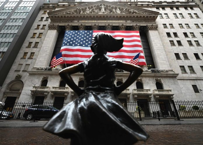 The Fearless Girl statue stands in front of the New York Stock Exchange near Wall Street on March 23, 2020 in New York City. (Photo by Angela Weiss / AFP)