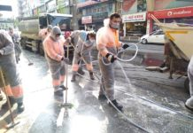 Photo taken with a cellphone shows staff conducting disinfection on the street in Istanbul, Turkey, March 30, 2020. Turkey on Monday announced 37 more deaths from COVID-19, while the total number of infection cases in the country has risen to 10,827. A total of 168 people have died from the novel coronavirus, Turkish Health Minister Fahrettin Koca tweeted. (Photo by Safar/Xinhua)