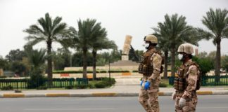 Members of security forces are seen in downtown Baghdad, Iraq, April 6, 2020. Iraqi Health Ministry on Monday said the number of confirmed COVID-19 cases has climbed to 1,031, and the death toll reached 64 in the country. The Iraqi authorities have taken several measures to contain the outbreak of COVID-19, including extending a nationwide curfew until April 19. (Xinhua/Khalil Dawood)