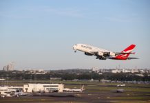 A Qantas airplane takes off from Sydney Airport, in Sydney, Australia, March 18, 2020. Virgin Australia airline announced Wednesday it would temporarily suspend all international flights as well as 50 percent of domestic services, in another blow to the industry by COVID-19. Australia's national carrier Qantas on Tuesday cancelled 90 percent of its international flights as well as 60 percent of its domestic capacity. (Xinhua/Bai Xuefei)