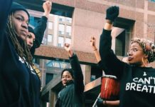 Black Lives Matter - Toronto co-founder Sandy Hudson (centre) with Jordan Monroe (left) and Pascale Diverlus (right) outside Toronto police headquarters at a protest in 2016. Photo by Paige Gallette