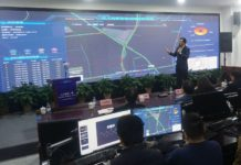 A staff member with the urban management bureau of Xiacheng district, Hangzhou, East China's Zhejiang Province, introduces the application of a new AI-based analysis system in urban management at a launch event, Nov. 21, 2019. Photo by Long Wei/People's Daily Online