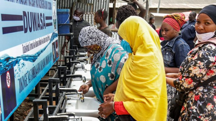 African Women In Tanzania Wash Hands During Covid Pandemic