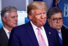 U.S. President Donald Trump addresses the daily coronavirus response briefing as National Security Advisor Robert O'Brien and Attorney General William Barr stand by at the White House in Washington, U.S., April 1, 2020. REUTERS/Tom Brenner