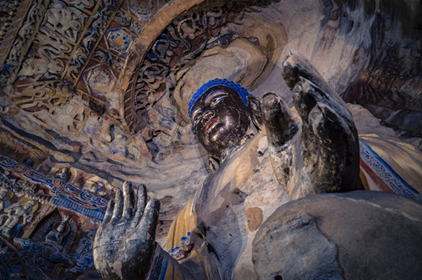 The photo taken on July 23, 2018 shows a Buddhist statue of the Yungang Grottoes, Datong, North China's Shanxi Province. Photo by Zhao Duo/People's Daily Online