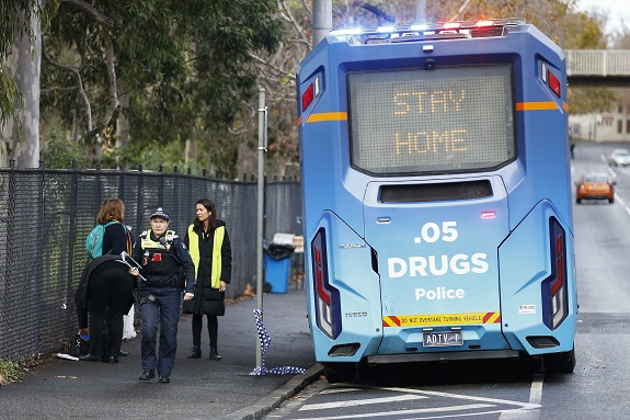 Police patrols are seen outside public housing towers in North Melbourne, Australia, 05 July 2020. Police are enforcing a lockdown at public housing towers in Melbourne after Victoria recorded over 100 new coronavirus cases. EPA/DANIEL POCKETT AUSTRALIA AND NEW ZEALAND OUT
