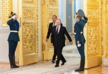 "Russian President Vladimir Putin (C) arrives for the ceremony of presenting credentials at the Kremlin in Moscow, Russia, Feb. 5, 2020. China is taking ""decisive and vigorous"" measures to fight the novel coronavirus, Vladimir Putin said Wednesday at the ceremony of presenting credentials by ambassadors of 23 countries, including China. (Xinhua/Bai Xueqi)"