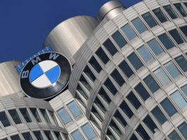 FILE PHOTO: The logo of German car manufacturer BMW is seen on the company headquarters in Munich, Germany, December 5, 2019. REUTERS/Andreas Gebert/File Photo GLOBAL BUSINESS WEEK AHEAD