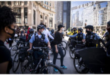 Demonstrators clash with police during a protest over the death of George Floyd in Chicago, the United States, on May 30, 2020. Chicago Mayor Lori Lightfoot imposed a curfew on the city on May 30. Chicago's precautions followed a chaotic and violent Saturday evening, when many businesses along the streets were looted, police cars overturned and some properties damaged. (Photo by Christopher Dilts/Xinhua)