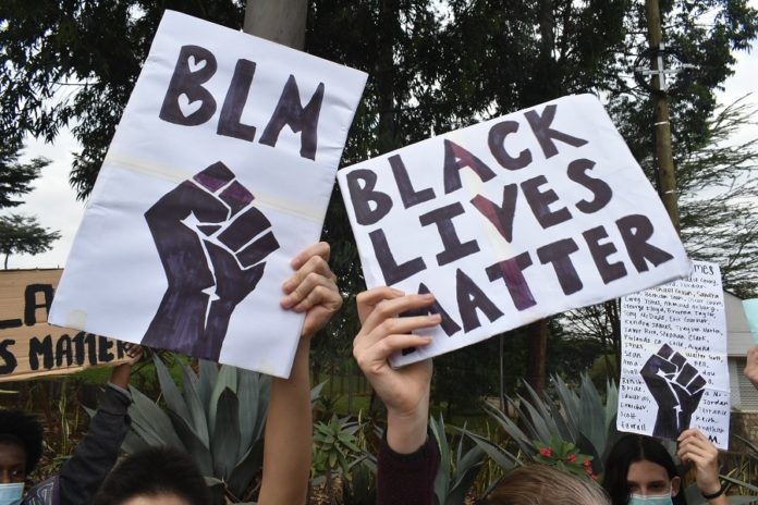 Protesters display placards in support of the 'Black Lives Matter' movement outside the United States Embassy in Nairobi, capital of Kenya, June 9, 2020. The death of George Floyd, an African-American man who was killed by police during an arrest in Minneapolis, United States, sparked worldwide protests calling for an end to police brutality and racism. (Xinhua/Joy Nyabukewa)