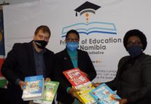 Anna Nghipondoka(R), Namibia's Education Minister, Rachel Odede (C), United Nations International Children's Fund (UNICEF) and Albe Botha, Namibia Media Holdings Chief Executive Officer display books during a handover event in Windhoek, capital of Namibia, July 2, 2020. Namibia's Ministry of Education, Arts and Culture on Thursday received 3.9 million Namibia dollars (230,000 U.S. dollars) from UNICEF for the production and printing of primary phase workbooks. The workbooks are part of the ministry's efforts to ensure effective continuous teaching and learning during the COVID-19 pandemic. (Xinhua/Musa C Kaseke)