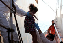 A Child Rescued In The Mediterranean Sea Reaches A Safe Port In Italy Iom File Photo