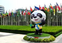 A CIIE mascot stands outside the venue of the 3rd CIIE in Shanghai, July 25. (Photo by Yan Daming/People's Daily Online)