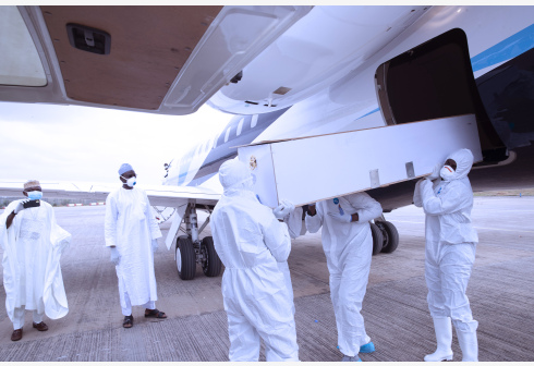 People in protective suits carry the coffin bearing the body of Mallam Abba Kyari, chief of staff to Nigerian President Muhammadu Buhari in Abuja, capital of Nigeria, April 18, 2020. A presidency statement confirmed early Saturday that Mallam Abba Kyari died while receiving treatment for COVID-19. (Xinhua/Olatunji Obasa)