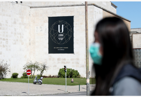 LISBON, March 10, 2020 (Xinhua) -- A woman wearing a mask walks past the University of Lisbon in Lisbon, Portugal, on March 10, 2020. Portuguese Prime Minister Antonio Costa said on Tuesday that the Portuguese people must be prepared for the worst-case COVID-19 scenario. As of Tuesday morning, 41 confirmed coronavirus cases had been reported in Portugal. (Photo by Pedro Fiuza/Xinhua)